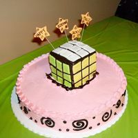 Rubik's Cube Cake   This cake was a pain in the butt to make. I doubt I'll do it again!