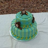 Monkeys!!! A monkey themed cake for an 8 year old's birthday that loves monkeys! The cake and icing were both vanilla. The diamonds, stripes, and...