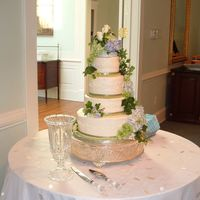 Cascading Roses And Hydrangeas Cake Continued. Side view of cascading roses and hydrangeas cake.