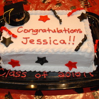 My Daughter's 8Th Grade Graduation Cake Double layer yellow cake, buttercream filling and icing with fondant accents.