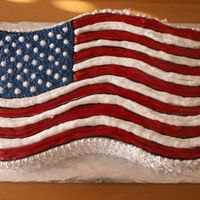 American Flag   Chocolate cake layers filled with chocolate custard. Buttercream Stars & Stripes.