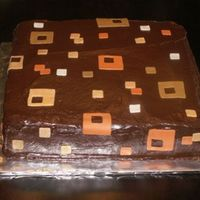 Squares Chocolate cake filled and iced with chocolate ganache. The squares were cut out of fondant.