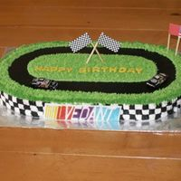 Nascar Birthday Cake Marble cake with custard filling, iced in buttercream. Cars and flags are non-edible. The plaque is gumpaste, and we took the birthday boy...