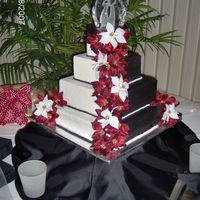 Black And White This cake was really a fun idea difficult to produce but I love the half black half white fondant.