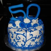 Blue Scrolls Chocolate cake, ganache filling, buttercream icing. Fondant 50. This was inspired by another CC member, but I cannot find the original...