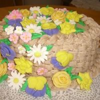 Basketweave Practice Just practicing my basketweave and using up extra flowers. Snickerdoodle cake with cinnamon b/c filling and frosting.