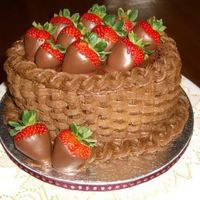 Chocolate Berry Basket This is a triple chocolate cake with chocolate syrup frosting filling and crumb coat, and chocolate buttercream basketweave.