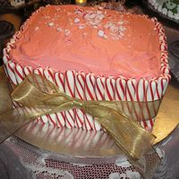 Candy Cane Cake red velvet cake, peppermint cream cheese frosting. add peppermint sticks and a big gold bow...... viola! easy. i made this for our annual...