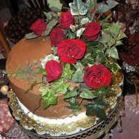 Christmas Roses another cake for the open house.chocolate cake, chocolate icing. i thought the roses and ivy were a nice touch.