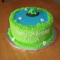 "Turtle Turtle & flowers are fondant, icing is BC. 8"" round cake."
