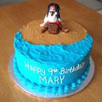 "Jack Sparrow  8"" round with BC icing, a few crushed graham cracker crumbs on the ""sand"". Jack is made from fondant. Based on RICKASH&#039..."