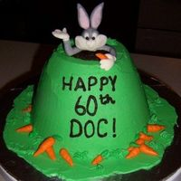 Bugs Bunny Cake Taken from Debbie Brown's Character Cakes book. (I just used a LOT less carrots!) Buttercream icing, fondant Bugs Bunny & carrots...