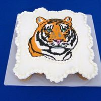 "Tiger Cupcake Cake   This was the ""groom's cake"" for a cupcake wedding I did recently. The tiger is a FBCT."