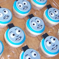 Thomas The Train Cupcakes   Made for a friend's 3 year old. He loved them! Fondant faces - piped buttercream details.