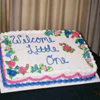 Welcome Little One This is a half sheet buttercream baby shower cake with buttercream roses.