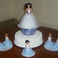 "A Bride With Her Bridemaids 14"" torted choc/wht marble. pound cake doll covered in fondant. mini dolls are butter cake covered in fondant ... all the dress tops..."