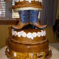 100_2025.jpg OUR FIRST WEDDING CAKE. IT WAS A WESTERN THEME.
