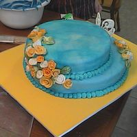 39Th Anniversary Cake! neat little cake with blue fondant. hand made all those little flowers from fondant and painted them all up. enjoy!