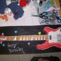 100_1229.jpg RICKENBACHER BASS GUITAR. IT WAS A 24TH B-DAY CAKE.