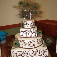 Peacock Themed Wedding Cake All buttercream with peacock feathers