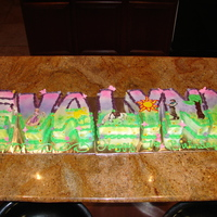 "Tangled Themed Cake Tangled cartoon theme, all buttercream with edible images. Spelled out the little girls name ""Evalynn"""