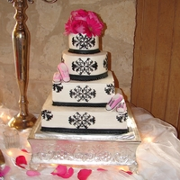 Four Tier Damask Print Wedding Cake All buttercream with fondant ribbon and fondant tennis shoes