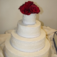 Four Tier Round White Wedding Cake All buttercream with fondant ribbon and rhinestones