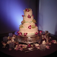 4 Tier Butter Cream Wedding Cake With Orchids All buttercream with fondant ribbon and fresh orchids