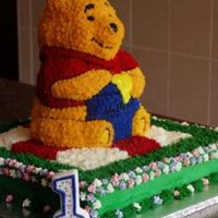 1St Birthday Cake Side My first cake, made for my son's 1st birthday. I decided to do Pooh on a picnic blanket on grass with some royal icing flowers, side...