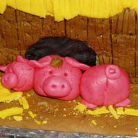 Fondant Nightmare - A Close-Up Take a closer look at the melting pigs, if you dare.