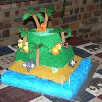 2Nd Birthday Cake  A 3D jungle animal cake made for my son's second birthday. It was the first time I worked with pettinice and my friend helped me. View...