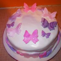 Butterfly Cake This was my first ever decorated cake, its a traditional Vanilla sponge with lots of raspberry and vanilla filling. Covered in fondant with...