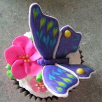Butterfly And Flower Cupcakes Chocolate cupcakes with hand-swirled vanilla buttercream. Royal Icing apple blossoms, violets and leaves. Color Flow butterflies look like...