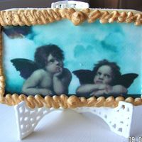 "Edible Image Angel Artwork Sugar cookie with royal icing and edible image placed on top. Royal icing ""frame"" around picture. Gold luster dust added to frame..."