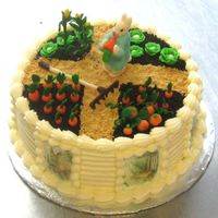 "Peter Rabbit Cake Carrot Cake with cream cheese frosting. Marzipan garden vegetables, Peter and rake. Oreo cookie crumbs garden ""dirt"" with graham..."
