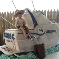 "Boat / Golf Cake Ii This cake was a gift for my cousin's 50th birthday. I've never done anything bigger than an 8"" round because I'm really..."