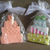 Fondant Wedding Cookies The patterns in the fondant were made by an impression mat I found at A.C. Moore (used for clay projects). The topsy turvy cookie was...