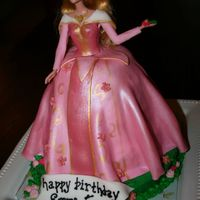 A Sleeping Beauty Fondant covered cake with gold luster accents.