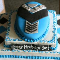 Blue Power Ranger Buttercream Frosting Base with Fondant Accents and Silver Luster Dust Applied