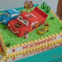 Lightning Mcqueen And Sally mcqueen and sally was made of sponge chocolate cake. covered with whip cream. for the label (rusteze), I use an edible image.