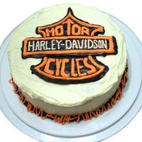 Harley Davidson Cake I had to put the logo on freehand as I couldn't find an image that was reversed! It is all butter cream icing, save for the black....