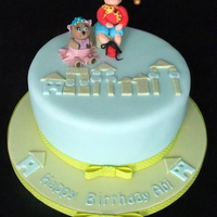 Abi's 2Nd Birthday Cake Round cake with noddy and tessie bear figures and toytown buildings