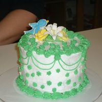 Cakeschristmasamber_024.jpg small six inch cake. all buttercream, with royal icing flowers.