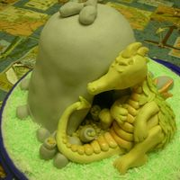 "Sleepy Dragon From ""Enchanted Cakes for Children by Debbie Brown"". This is for my son's4th BD yesterday."