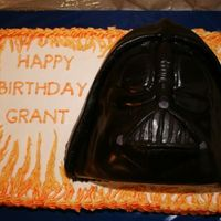 Darth Vader Chocolate cake with buttercream and chocolate rolled buttercream for Darth. Darth Vader was carved from a frozen cake then covered in...