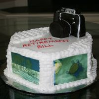 Retirement To Photography Hobby Camera is made from cake and fondant with silver luster dusted accents. This was a retirement cake for a gentleman who planned to continue...