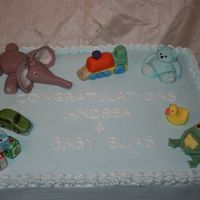 Baby Boy Shower White sheet cake with buttercream icing. All the decoration is fondant.