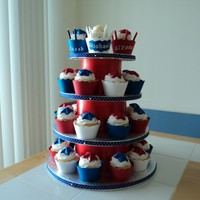 Red, White And Blue Cupcake Tower   30 French vanilla cupcakes, iced in buttercream. Stars are made out of chocolate. I made the cupcake wrappers and the cupcake stand. TFL!