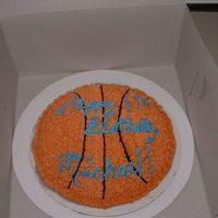 Baketball Cake I used the largest pyrex bowl and baked the cake in it. I uses a lemon BC and lemon filling with Vanilla cake. #18 star tip for backetball...
