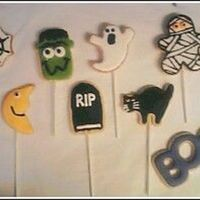 Halloween Cookies these are my first decorated cookies EVER! nfsc and antonia's ri. spider web, moon, frankenstein, tombstone, ghost, cat, mummy, and...